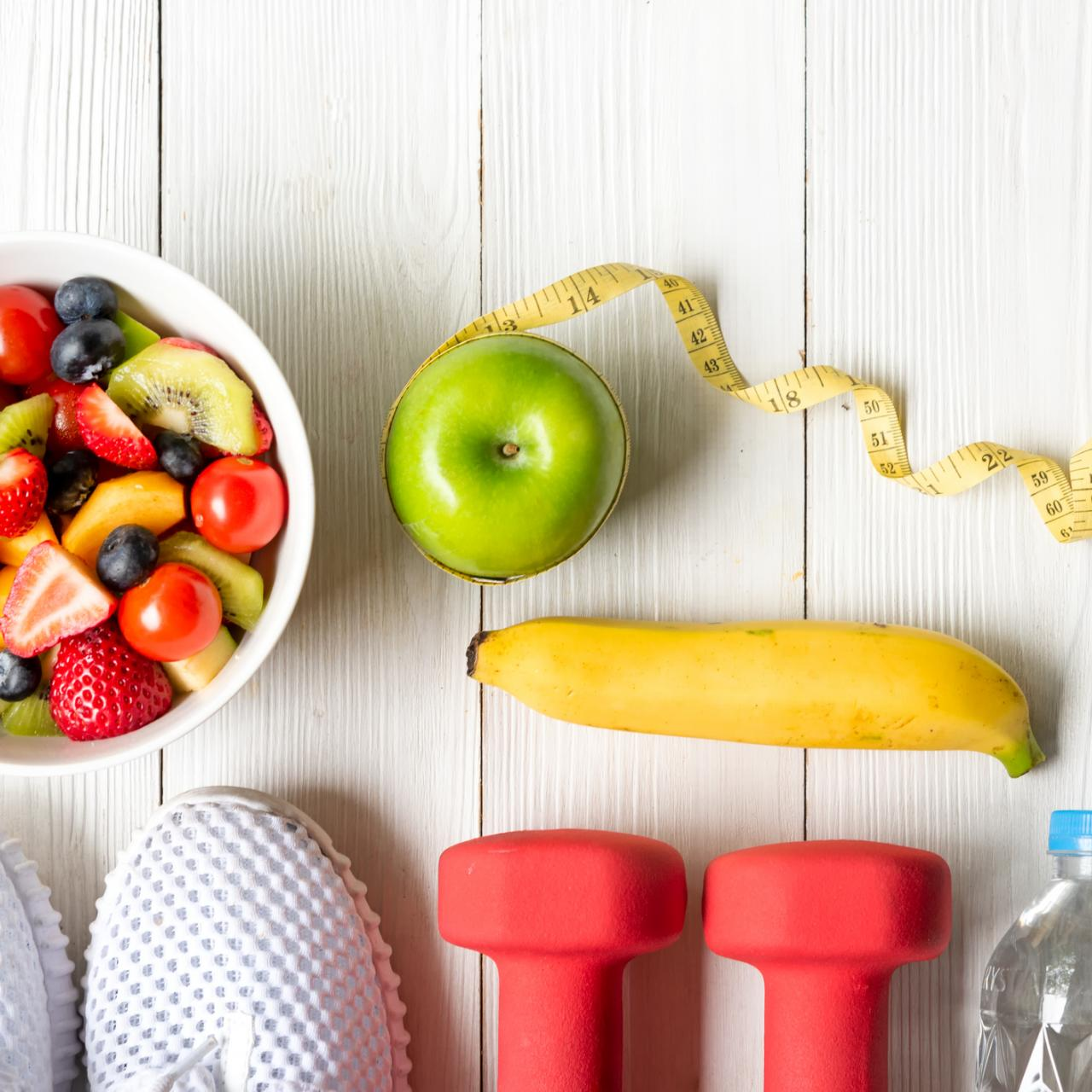 healthy items: weights, water, sneakers, fruit