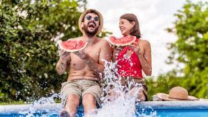 Couple eats watermelon in pool