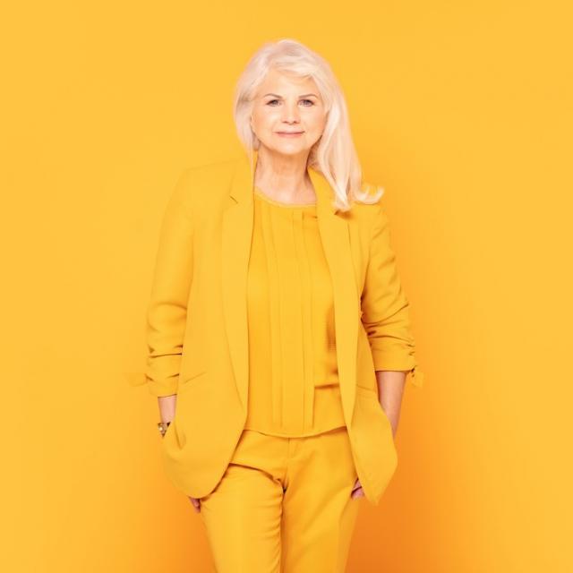 Smiling woman wearing yellow