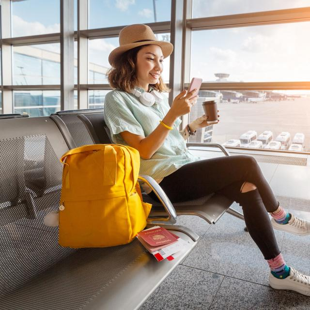 Woman waits in airport