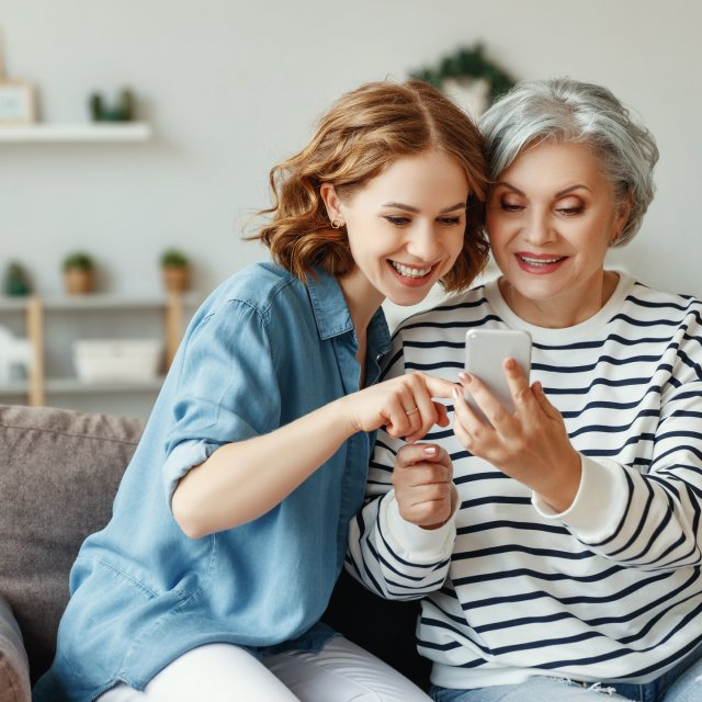 Daughter Teaches Mother to Use Cell Phone