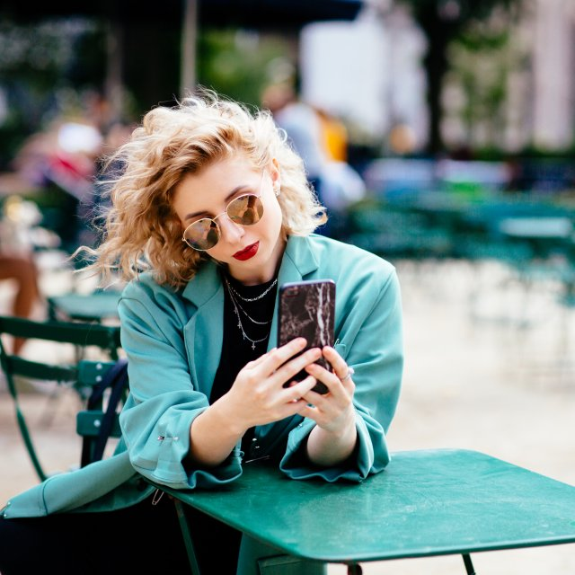 Blonde girl with fashionable phone case