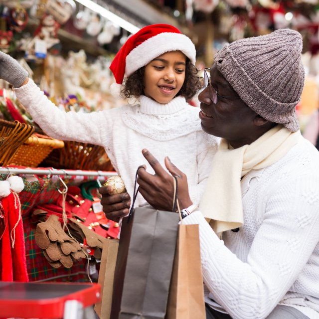 Father and daughter holiday shopping