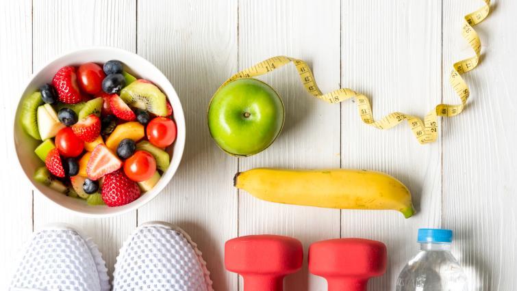 healthy items: weights, water, sneakers, fruit